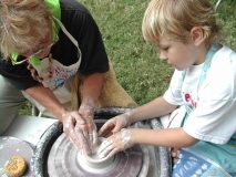 Child at pottery wheel