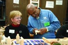 Woodcarving student and instructor