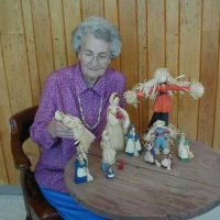 Annie Lee Bryson with dolls