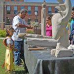 John Grant carving at show