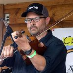 Lucas Pasley playing fiddle
