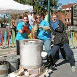 M. Rathsack demonstrates raku pottery firing at Art on Main in Henderson County.