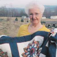 Delta Peterson with quilt